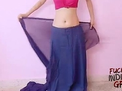 young indian wife teaching in any event to wear saree